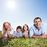 Beautiful family lying on the grass and enjoying in the nature. They are looking at the camera.   [url=http://www.istockphoto.com/search/lightbox/9786778][img]http://dl.dropbox.com/u/40117171/family.jpg[/img][/url]  [url=http://www.istockphoto.com/search/lightbox/9786750][img]http://dl.dropbox.com/u/40117171/summer.jpg[/img][/url]